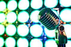 Retro microphone on stage. In restaurant. Blurred background Royalty Free Stock Photo