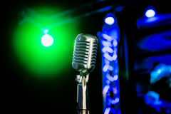 Retro microphone. On the stage royalty free stock photography