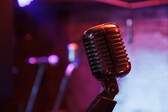 Retro microphone on stage Stock Photos