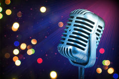 Retro microphone with stage lights Royalty Free Stock Image