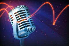 Retro microphone with stage lights Stock Photography