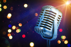 Retro microphone with stage lights Stock Photo