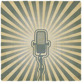 Retro microphone. striped old background Royalty Free Stock Photo