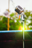 Retro microphone on vintage outdoor background royalty free stock photos