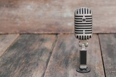 Retro microphone. Vintage style on the wooden floor background Stock Images