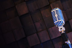 Retro microphone on wood brown background. stock images