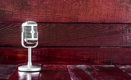 Retro microphone. On wooden table Stock Image