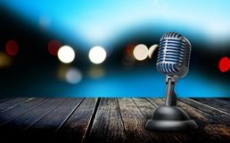 Retro microphone on wooden table royalty free stock photos