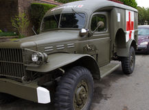 Retro military ambulance in neighborhood Stock Photo