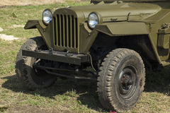 Retro military auto. In the field Stock Photography