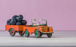 Retro model of car Land Rover laden with blackberries. Royalty Free Stock Image