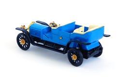 Retro model car, on white background. Model of retro car, blue on white background Stock Photography