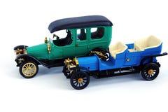 Retro model car, on white background. Model of retro car,green and blue on white background Stock Photography
