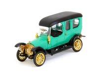 Retro model car, on white background. Model of retro car,green  on white background Royalty Free Stock Image