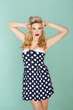 Retro model in polka dot dress Stock Photos
