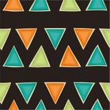 Retro modello senza cuciture con i triangoli un fondo marrone Fondo geometrico nei colori d'annata Fotografia Stock