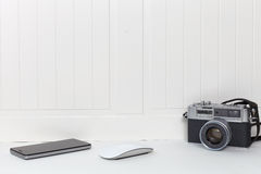 Retro and modern utensil. White wall and shelf with frame and modern and vintage utensil Stock Photos