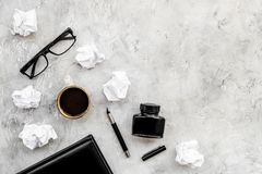 Retro and modern writer desktop with glasses, notebook and ink on stone background top view mock up. Retro and modern writer desktop with glasses, notebook and royalty free stock image
