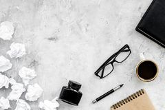Retro and modern writer desktop with glasses, notebook and ink on stone background top view mock up. Retro and modern writer desktop with glasses, notebook and stock images