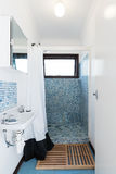 Retro mosaic tiled shower bathroom in Australian holiday house Stock Photos