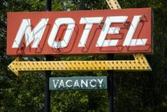 Retro Motel Sign. An old retro style motel sign with vacancy stock photos
