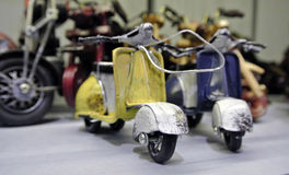 Retro moto. Toy miniature retro scooter manual Assembly, at the exhibition stand Royalty Free Stock Photo