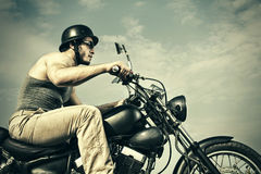 Retro Motorbiker. Portrait of retro Motorbiker Riding Stock Photography