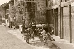 Retro oldtimer motorbikes in the rustic town of Xingping, China. Two retro motorcycles in the ancient town of Xingping, near Guilin, in the province Gunagxi Stock Images