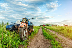 Retro motorcycle on country road Stock Photo