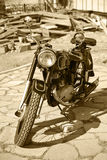 Retro motorcycle in court yard Royalty Free Stock Images