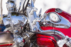 Retro  motorcycle  on the street -closeup Royalty Free Stock Photos