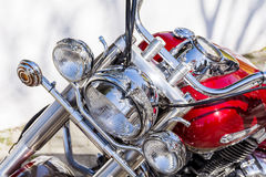 Retro  motorcycle  on the street -closeup Royalty Free Stock Photography
