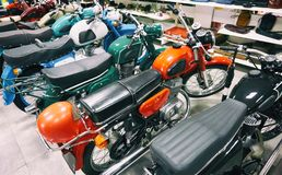 Retro motorcycles in store. Retro motorcycles in the store royalty free stock photos