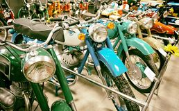 Retro motorcycles in store. Retro motorcycles in the store royalty free stock images