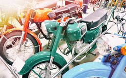 Retro motorcycles in store. Retro motorcycles in the store stock photography
