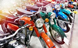 Retro motorcycles in store. Retro motorcycles in the store stock photo