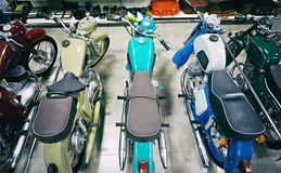 Retro motorcycles in store. Retro motorcycles in the store royalty free stock photo