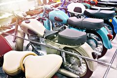 Retro motorcycles in store. Retro motorcycles in the store stock image