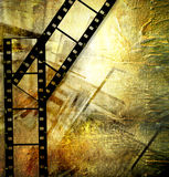 Retro movie. Artistic background in grunge style with film strips Royalty Free Stock Images