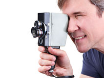 Retro movie camera in hands of operator isolated Royalty Free Stock Photography
