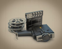 Retro movie camera movie clapper and film reel. Movie camera, movie clapper and film reel on a retro background. 3d illustration Stock Images