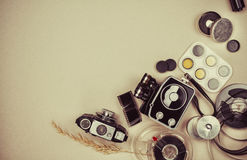 Retro movie camera and photo Stock Photography