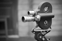 Retro movie camera on a tripod. Stock Photos