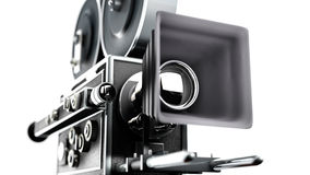 Retro movie camera. Vintage movie camera isolated on white right side close up Royalty Free Stock Photography