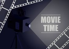 Retro movie projector on a blue background with movie strip. Vector background Stock Photos