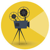 Retro movie projector on a yellow background. Flat vector illustration Stock Images