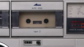 Retro music cassette player playing a compact audio cassette tape stock video footage