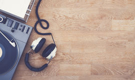 Retro music hero header. Top view of Retro music hero header with record player, tuner and headset. Copy space Stock Photo