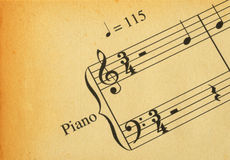 Retro music note. Close-up of retro music note on yellowed paper royalty free stock images