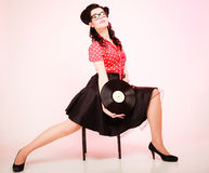 Retro music. Pinup girl with vinyl record Stock Images